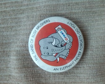 The band of busy brushes an elephant never forgets do you badge by crest 1950s