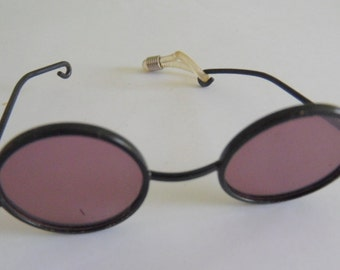 Pair of wire rimmed sunglasses for your doll.