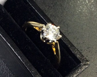 18ct gold diamond solitaire ring ,half carat