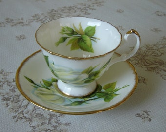 Paragon E50H white yellow Rose cup and saucer near mint condition (1D)