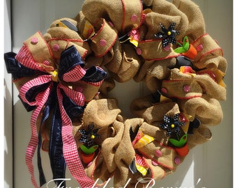 Burlap Wreath with black and resnaccent decorations.