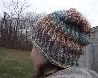 tan and muticolored knitted hat