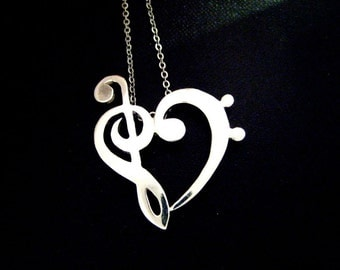 Bass clef and silver heart pendant