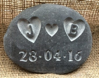 Love PEBBLE with initials carved into the hearts! along with a date, all hand carved into the stone &  personalised