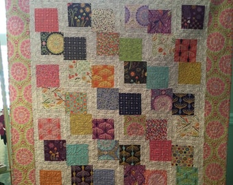 Multi color lap quilt