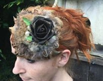 Rabbit fur and pheasnat feather fascinator, with black rose and pearls.