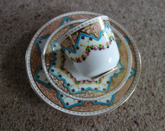Antique Hand painted rose garland  with gold trio cup saucer and plate
