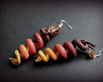 Fantasy red dragon earrings from polymer clay