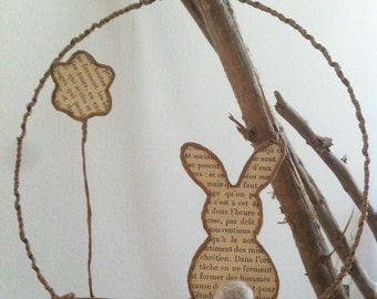 Easter bunny ornament made of wire and old French book pages