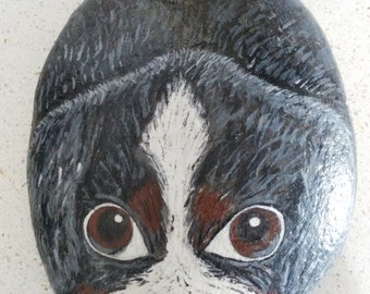 Sea stone hand painted depicting doggy