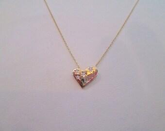14k yellow heart pendant with 4 small diamonds