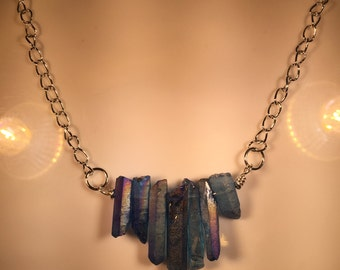 Light Blue Quartz necklace on Silver 22 gauge wire hanging on silver box chain 18 inches long.