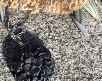 Carved black cinnabar necklace.