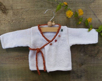 Baby wrap cardigan for newborn babies.