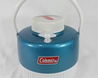 Vintage blue Coleman water jug cooler