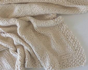 Soft, handknitted cotton baby blanket