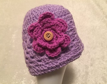 Purple Crocheted hat with pink flower