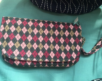 Pink argyle diaper clutch with changing pad