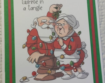 Mr and Mrs Claus All Tangled Up