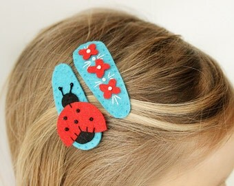 A pair of felt hair clips - red flowers and a ladybug -orange flowers and a ladybug - girl birthday gift