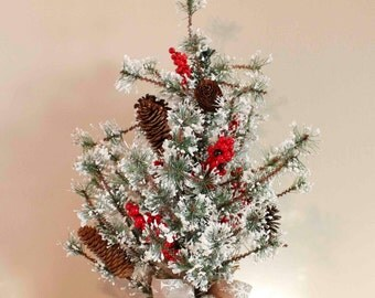 A Beautiful White ChristmasTabletopTree with Natural Real Pinecones and Red Berries.
