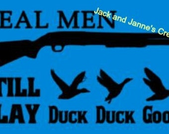 Real Men still play DUCK DUCK GOOSE graphic T-shirt.  Perfect for hunters.