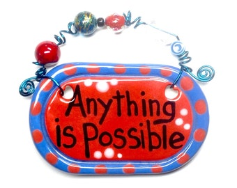 Anything is possible red ceramic sign