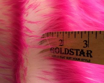 Super soft faux fur twotone shaggy fabric fuschia/offwhite. Sold by the yard