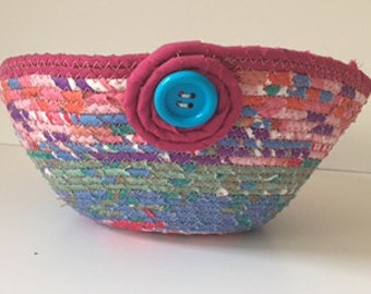 Pink coiled basket with blue button