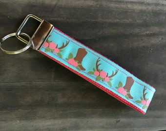 Boot & antler flower teal and pink wristlet