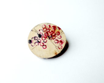 Pink and purple hand painted wooden brooch.