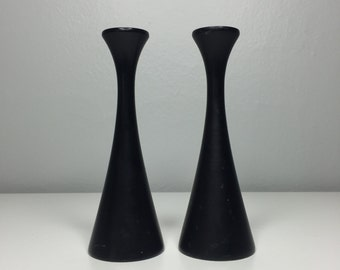 set of two black wooden mid century modern candleholders made in Sweden
