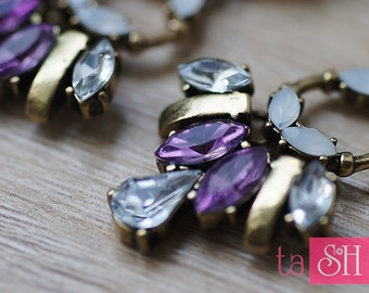 Earrings with purple crystals