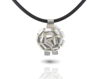 Silver gift bow pendant on black rubber necklace