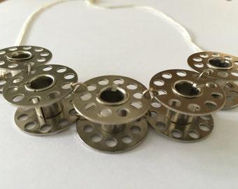 Metalic bobbin necklace