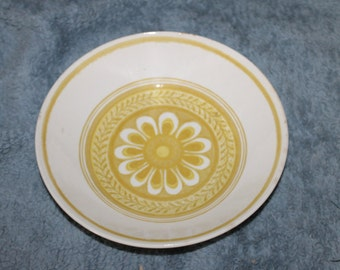 A Beautiful Bowl, 9 Inches in Diameter, Great Serving Dish, I think it is Porcelain and it Has a Yellowish Glaze w a Flower Design