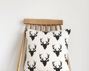 Black stag cushion, feather insert included.