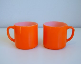 Pair of Bright Orange Milk Glass Mugs by Federal Glass