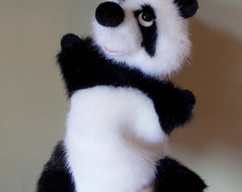 Panda. Big panda. Toy on hand. Puppet theatre. Bibabo. Toy glove. Marionette.