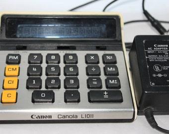 Canon Canola L1011 Calculator w/Adaptor -- Canon Japan -- AC Adaptor/Battery -- 10 Digit Display -- Penlight Battery -- 1970/80's