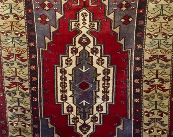 Vintage handmade wool Turkish rug 5x9 ft