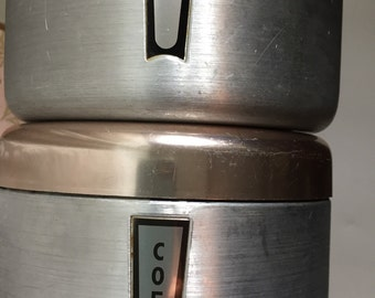 Vintage canisters, nest on top of each other, for tea and coffee.  Mid century retro metal.