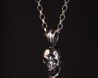925 sterling silver skull pendant and round garnet