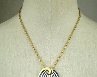 Signed Eisenberg black and off white spiral pendant necklace, op art 1960s