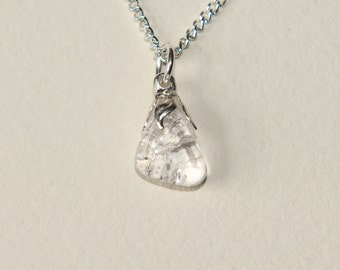 Clear quartz (rock crystal) on a silver plated chain