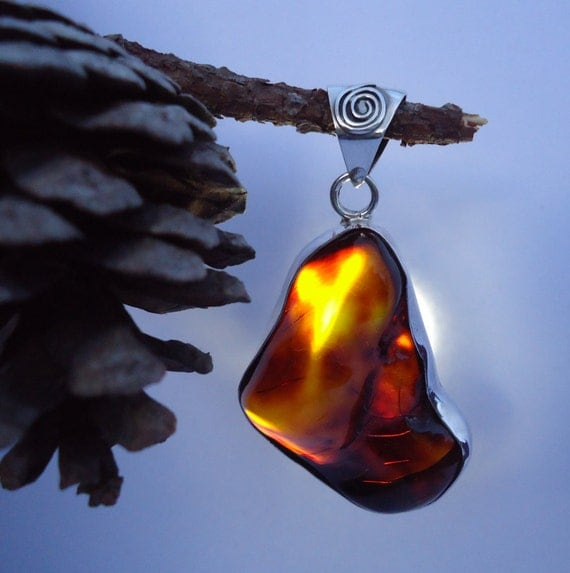 Mexican amber. Rare orange amber sterling silver pendant. Natural free form shape. Spiral design