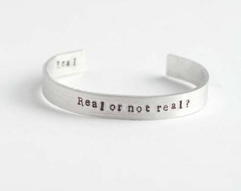 Real or not real bracelet, the hunger games bracelet, Mockingjay bracelet, Katniss bracelet, Peeta, Hand Stamped bracelet, Valentines gift