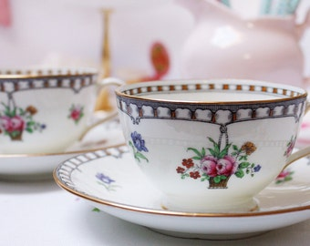 An exquisite hand painted  Aynsley fine bone china teacup and saucer: a quality cup and saucer with lovely detail.