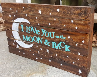 I love you to the moon and back wooden sign. Rustic wooden sign