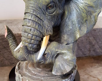 Elephant bust with baby elephant elephant for the collector trunks up with tusks awesome detail vintage